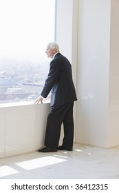Senior businessman looking out