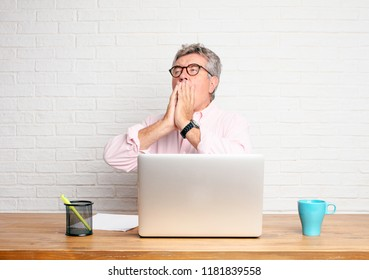 senior businessman Looking unenthusiastic and bored, listening to something dull and tedious, yawning in utter boredom.