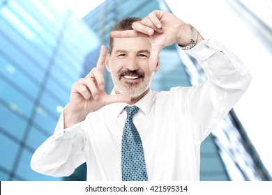 Senior businessman making a square shape, gesture.