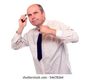 Senior businessman with phone.