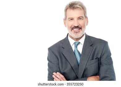 Senior businessman posing confidently