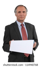 Senior businessman reading calendar