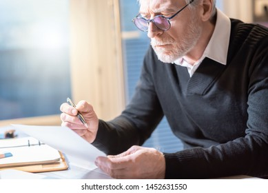 Senior businessman reading a document at office