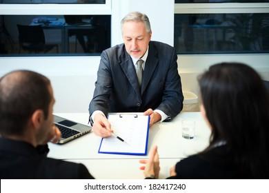 Senior businessman showing a document