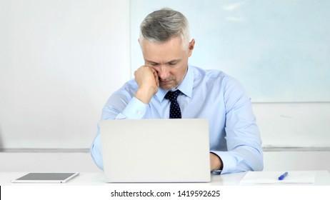 Senior Businessman Sleeping at Work