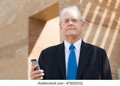 Senior Businessman with Smartphone