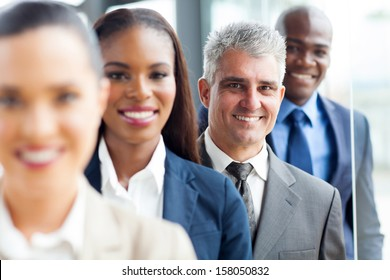 senior businessman standing in a row with colleagues