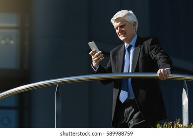 Senior Businessman in the Street. Business Concept