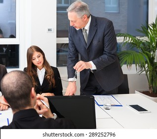 Senior businessman talking during a meeting in an office