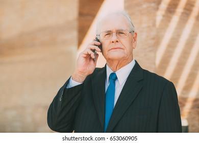 Senior Businessman Talking on Smartphone