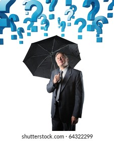 senior businessman with umbrella and 3d question mark