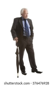 Senior businessman with umbrella  isolated over white background