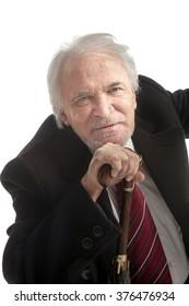 Senior businessman with umbrella  isolated over white background, portrait