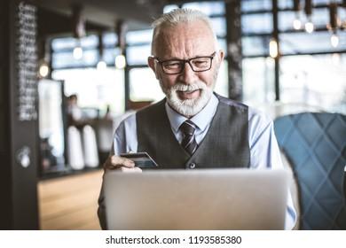 Senior businessman using e banking.