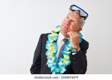 Senior businessman wearing suit hawaiian lei diving goggles over isolated white background with hand on chin thinking about question, pensive expression. Smiling with thoughtful face. Doubt concept.