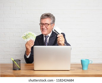 senior businessman working with his laptop. money concept