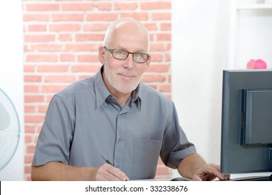 Senior businessman working on computer in his office
