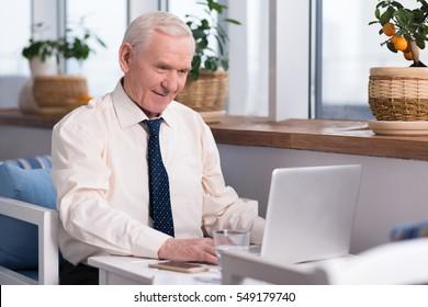 Senior businessman working on his presentation