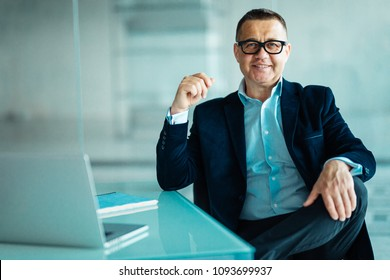 Senior businessman working on laptop computer in office