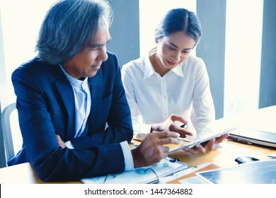 Senior businessmen are consulting and business plans with new generation businessmen.