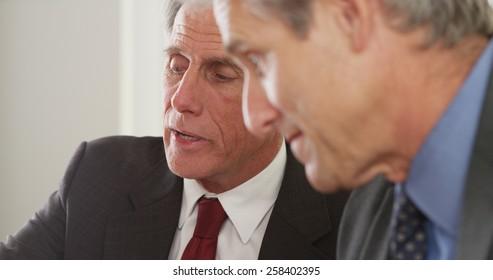 Senior businessmen talking in the office