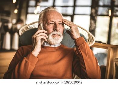 Senior businessmen talking phone.