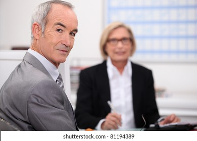 Senior businesspeople in interview