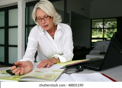 Senior businesswoman working at home
