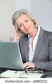 Senior businesswoman working in the office