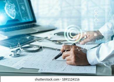 Senior cardiologist doctor analysis and diagnose checking heart disease testing result with virtual screen on laptop, Electronic medical record, Medical technology and science.