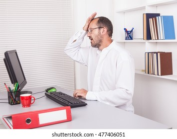 Senior caucasian businessman in office with problem