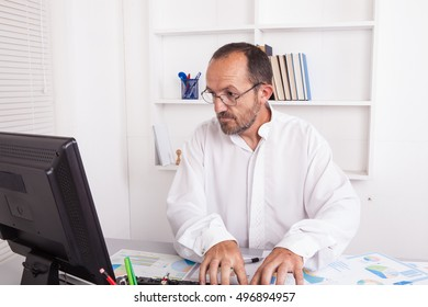 Senior caucasian businessman in office working