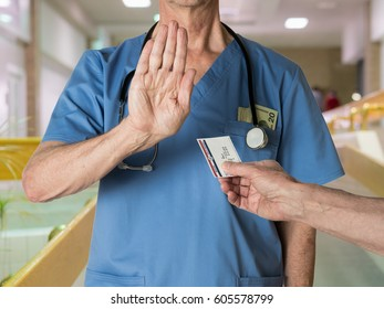 Senior caucasian doctor in scrubs in hospital refusing to treat a patient with a Medicare card