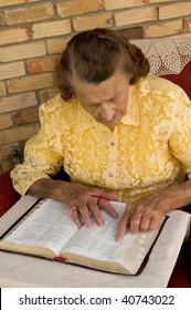 senior caucasian female reading the Bible