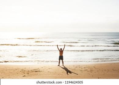 Senior caucasian man standing at the beach