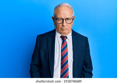 Senior caucasian man wearing business suit and tie skeptic and nervous, frowning upset because of problem. negative person.