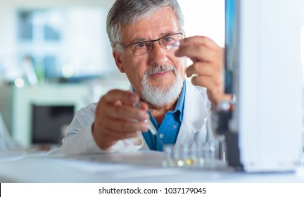Senior chemistry professor/doctor carrying out research experiments  in an analytical chemistry lab (color toned image)