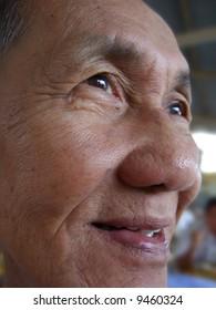 Senior chinese man smiling looking at far side