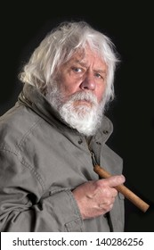 Senior with cigar - elderly man with beard and cigar