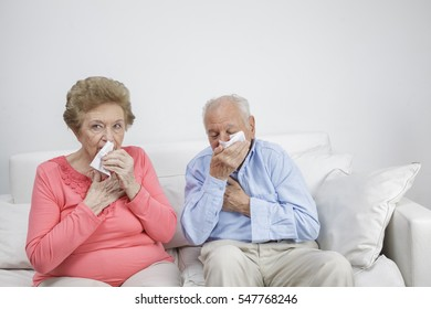 Senior citizen with the common cold and blow one's nose with tissue paper