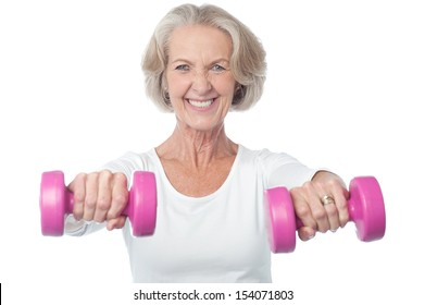 Senior citizen doing exercise with dumbbells