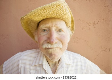 Senior Citizen Man with a Funny Expression Wearing a Straw Cowboy Hat