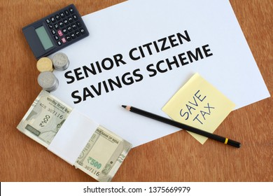 Senior citizen savings scheme, an investment avenue for Indian citizens of age 60 and above, concept highlighted through text, Indian rupees and coins, a save-tax note, calculator and pencil.