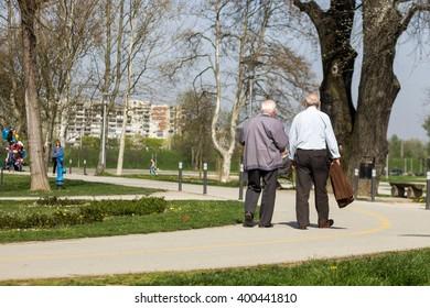 Senior citizen  taking a walk in a park.