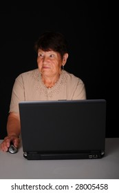 Senior citizen woman working on a laptop computer
