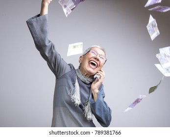 Senior classy lady throwing money in the air, euro bills, enjoying wealth and prosperity