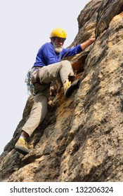 Senior climber in action - isolated. Shot in Gifberg Mountains, near Wanrhynsdorp, Western Cape, South Africa.