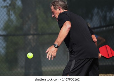 A senior competes in the singles division of a pickleball tournament