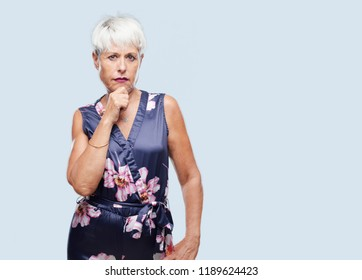 senior cool woman with a goofy, dumb, silly look, feeling shocked and confused at a recent realization, not really understanding an idea.