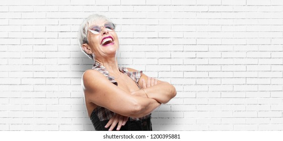 senior cool woman Laughing out loud with head tilted backwards and happy, cheerful expression
